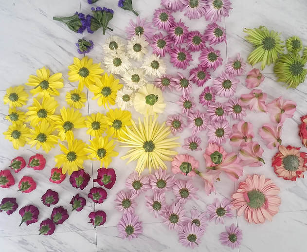 Yes, you need to use real flowers when taking milk bath photos. Fake flowers sink