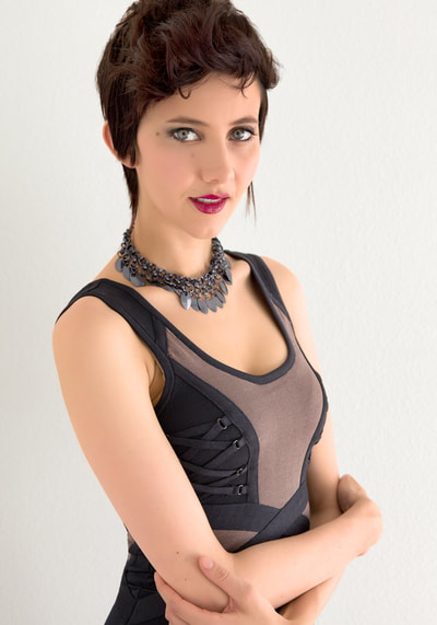Glamour photo of a young woman wearing a tight black dress