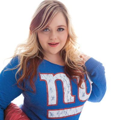 sexy portrait of a plus-size woman wearing a New York giants football jersey