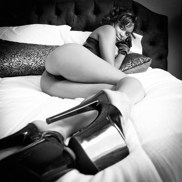 Glamour boudnoir photography of a young woman wearing 8 inch stiletto heels