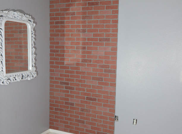 How to mount a faux brick wall panel